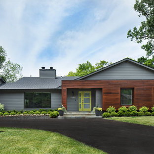 Contemporary gray one-story mixed siding gable roof idea in Detroit with a shingle roof