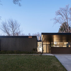 Midcentury Exterior by cityhomeCOLLECTIVE