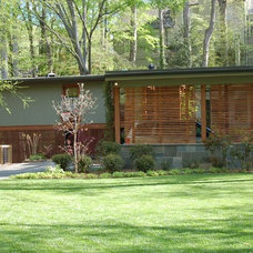 Midcentury Exterior by Clark & Zook Architects, LLC