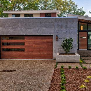 Inredning av ett retro mellanstort grått hus, med tre eller fler plan, blandad fasad, pulpettak och tak i metall