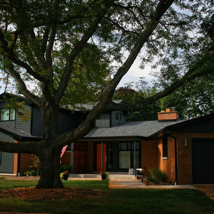 Inspiration for a mid-sized mid-century modern blue two-story mixed siding gable roof remodel in Chicago