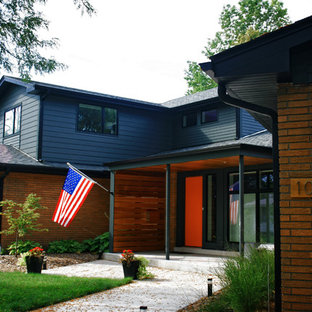 Mid-sized midcentury modern blue two-story mixed siding gable roof idea in Chicago