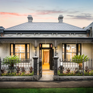 This is an example of a victorian one-storey white house exterior in Melbourne with a hip roof and a tile roof.