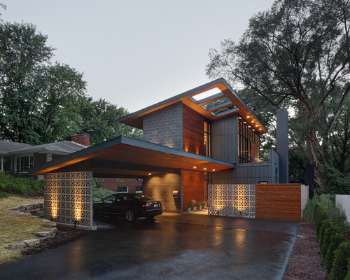 inspiration for a mid sized 1960s gray two story mixed siding exterior home remodel