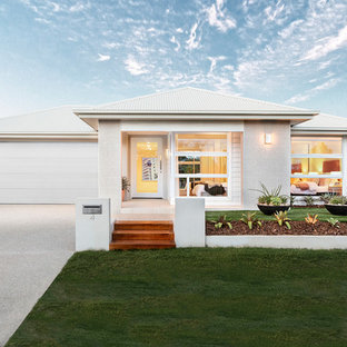 Design ideas for a beach style one-storey white house exterior in Brisbane with mixed siding, a hip roof and a metal roof.