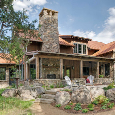 Mountain style brown one-story mixed siding exterior home photo in Other with a metal roof