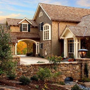 Mid-sized mountain style beige two-story wood exterior home photo in Other