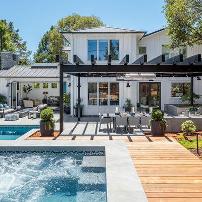Inspiration for a transitional white two-story wood house exterior remodel in San Francisco with a metal roof