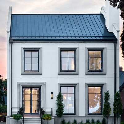 Transitional white two-story exterior home photo in Chicago with a metal roof