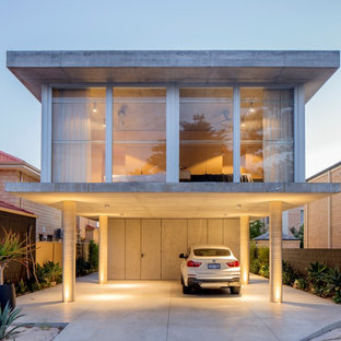 Design ideas for an industrial two-storey concrete grey house exterior in Perth with a flat roof and a mixed roof.