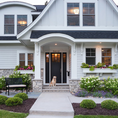 Large elegant white two-story concrete fiberboard gable roof photo in Minneapolis
