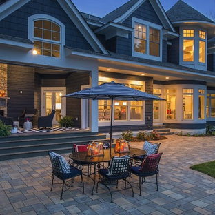 Inspiration for a huge transitional blue three-story concrete fiberboard exterior home remodel in Minneapolis