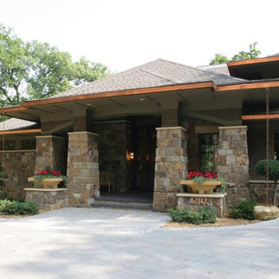Inspiration for a large asian one-storey brown house exterior in Minneapolis with stone veneer, a hip roof and a shingle roof.