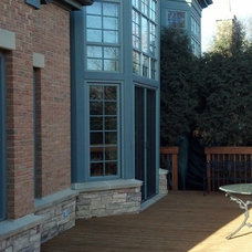 Traditional Exterior by Retractable Screens, LLC