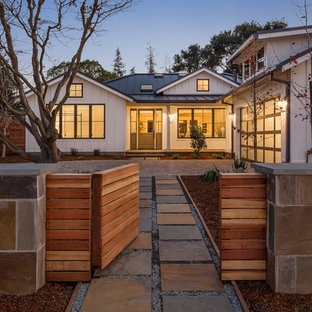 Example of a farmhouse white one-story gable roof design in San Francisco