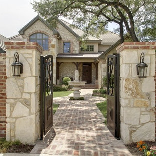 Country exterior in Austin with stone cladding.
