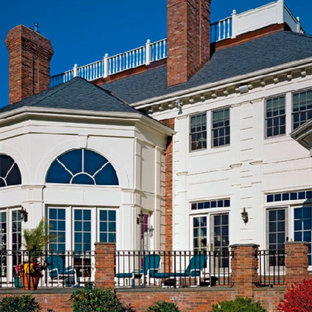 Large transitional white three-story mixed siding gable roof idea in Boston