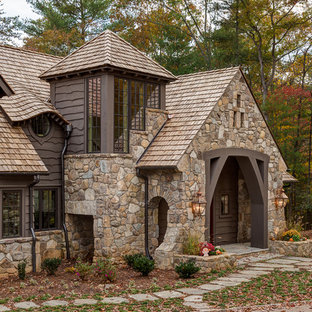 Inspiration for a large rustic brown two-story mixed siding gable roof remodel in Other
