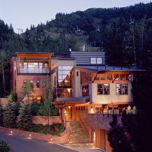 Design ideas for a large contemporary two-storey beige exterior in Denver with mixed siding.