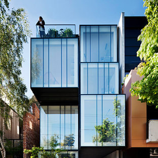 Design ideas for a contemporary glass house exterior in Melbourne with three or more storeys and a flat roof.