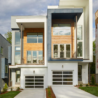 Inspiration for a mid-sized contemporary white two-story mixed siding exterior home remodel in Nashville