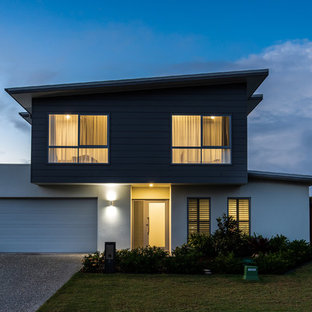 Design ideas for a large contemporary two-storey multi-coloured house exterior in Sunshine Coast with concrete fiberboard siding, a flat roof and a metal roof.