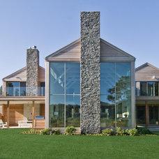 Farmhouse Exterior by Plum Builders, Inc.