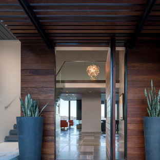 Mid-sized modern brown two-story wood house exterior idea in San Francisco with a hip roof and a metal roof