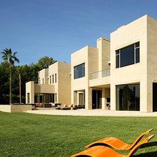 Contemporary Exterior by Finton Construction