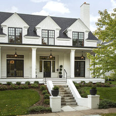 Transitional Exterior by Charlie & Co. Design, Ltd