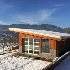 Modern Exterior by Conscious Construction Inc.