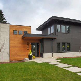 Mid-sized minimalist gray two-story mixed siding flat roof photo in Seattle