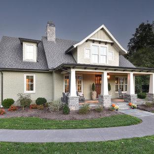 Ejemplo de fachada de casa verde, de estilo americano, de dos plantas, con revestimiento de ladrillo y tejado de varios materiales