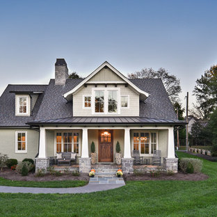 Example of an arts and crafts gray two-story brick exterior home design in Other with a mixed material roof