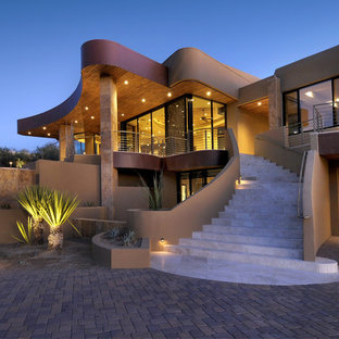 Inspiration for a large southwestern brown two-story mixed siding exterior home remodel in Phoenix
