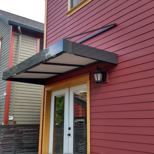 Large transitional red two-story concrete fiberboard gable roof idea in Portland
