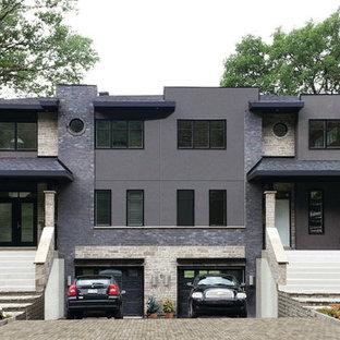 Ispirazione per la facciata di una casa bifamiliare grande nera contemporanea a due piani con rivestimento in pietra