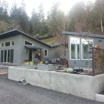 Modern, Energy Efficient Home with outdoor living space, raised bed gard