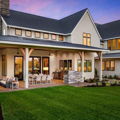 Inspiration for a huge farmhouse gray two-story wood exterior home remodel in Portland with a metal roof
