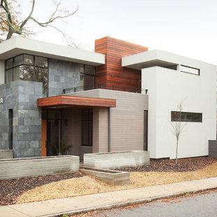 Idee per la facciata di una casa moderna a due piani di medie dimensioni con rivestimenti misti