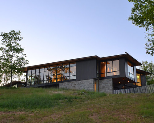 Example Of A Minimalist Glass Exterior Home Design In Charlotte