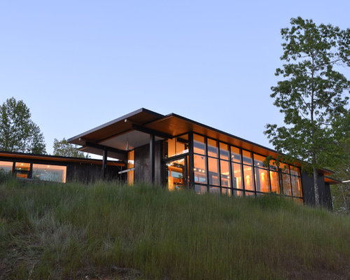 Example of a minimalist one-story exterior home design in Charlotte