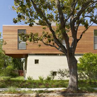 Modelo de fachada moderna con revestimiento de madera