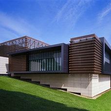 Modern Exterior by HERMOGENO DESIGNS
