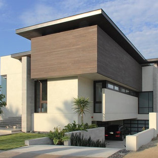 Example of a minimalist wood exterior home design in Orange County