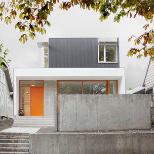 Inspiration for a mid-sized modern white two-story metal exterior home remodel in Seattle