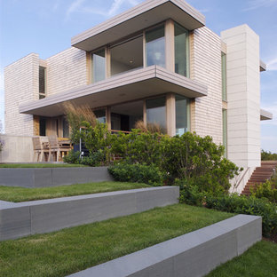 Example of a minimalist two-story wood exterior home design in New York