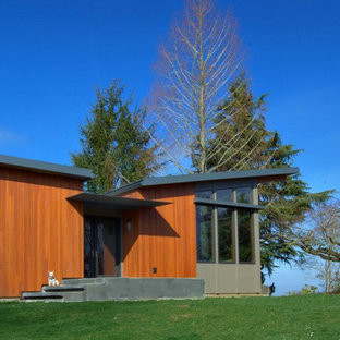Inspiration for a modern wood exterior home remodel in Portland