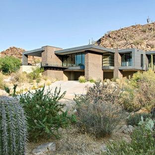 Example of a minimalist brick flat roof design in Phoenix