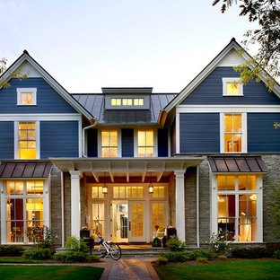 Country two-story stone gable roof photo in Chicago